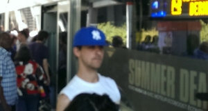 "Yankee fan in a ""dodger blue"" hat"