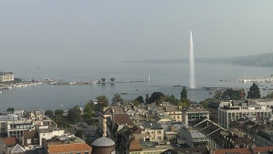 The jet d'eau as seen from the Old City squirts water way up into the somewhat overcast Geneva sky.
