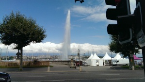 The majestic Jet d'eau squirts a stream of water way up into the clear blue Geneva sky