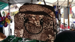 The perfect complement to her faux leopard skin ensemble.