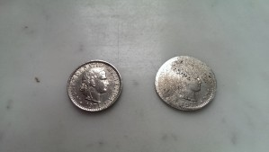 A 20 cent piece, before and after getting run over by a tram.  The one on the right is the one that got run over.